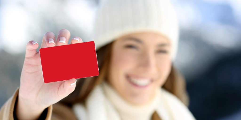 woman smiling holding gift card
